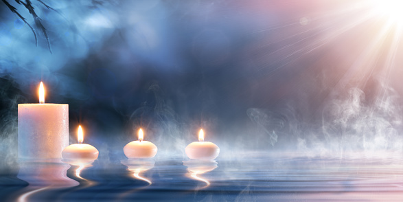Candles On Thermal Water With Sunshine
